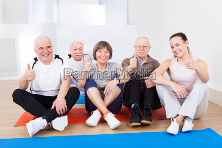 female trainer with senior customers at