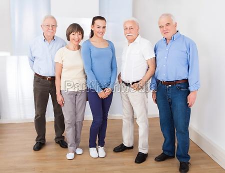 happy caregiver with senior people