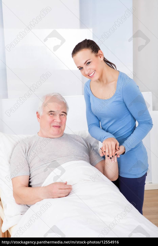 portrait, of, happy, caregiver, with, senior - 12554916