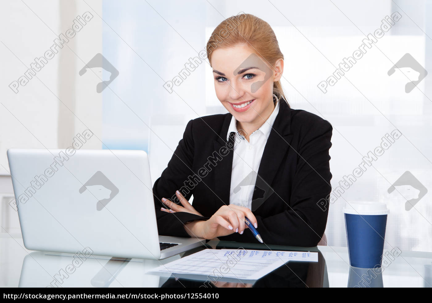 portrait, of, happy, young, businesswoman - 12554010