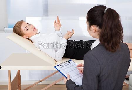 psychiatrist, examining, patient - 12554144