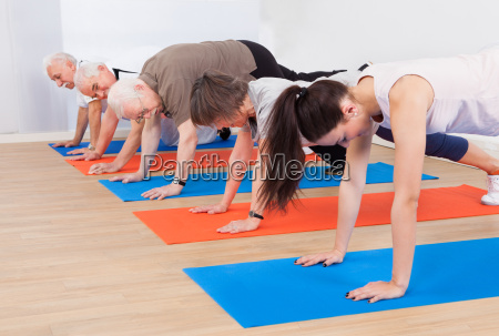 trainer, and, customers, doing, push, ups - 12554646