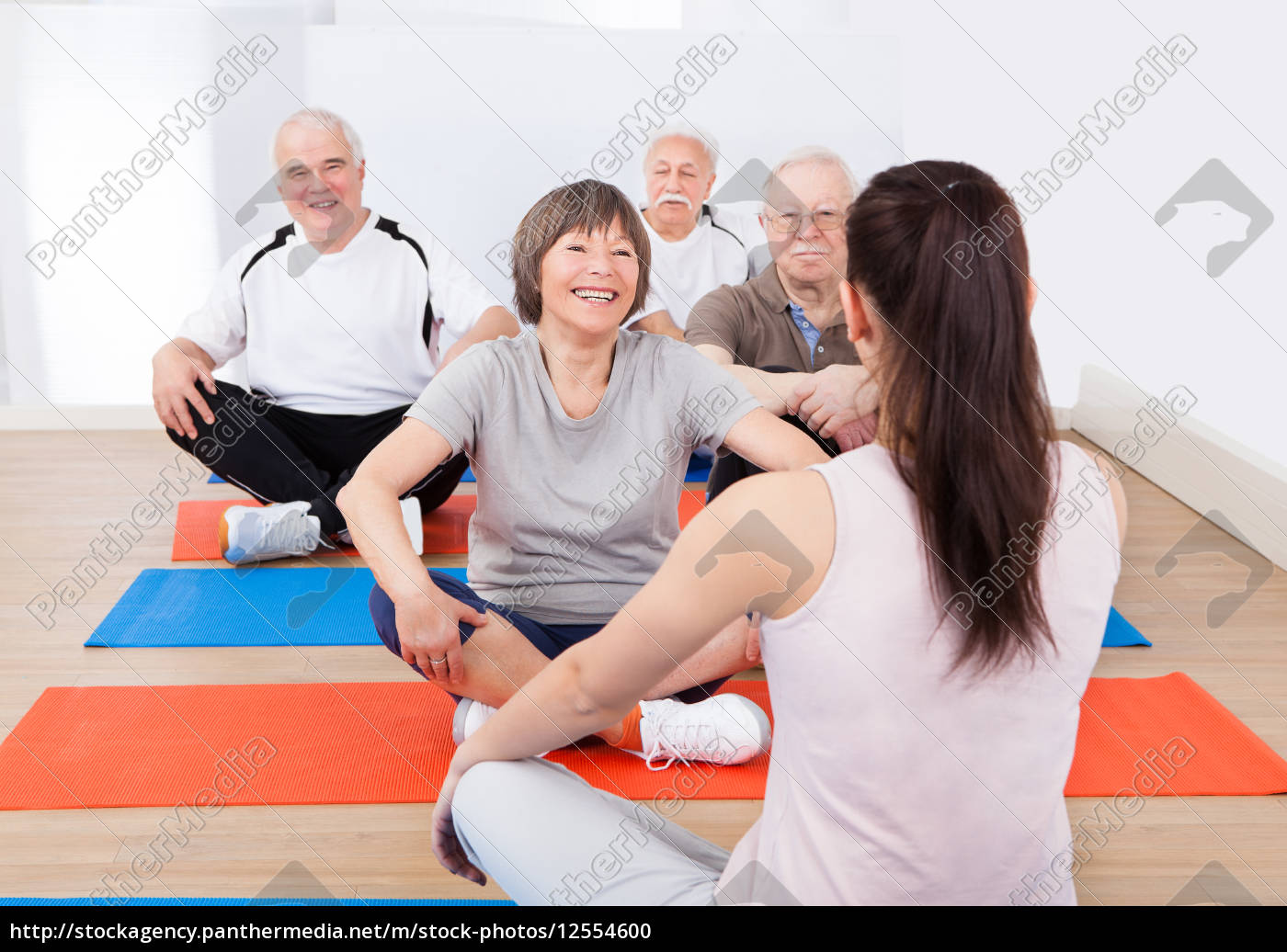 trainer, training, customers, in, yoga, class - 12554600