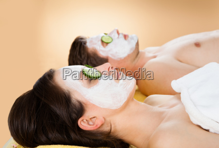 couple with face mask relaxing in
