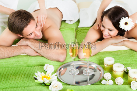 couple enjoying shoulder massage at spa