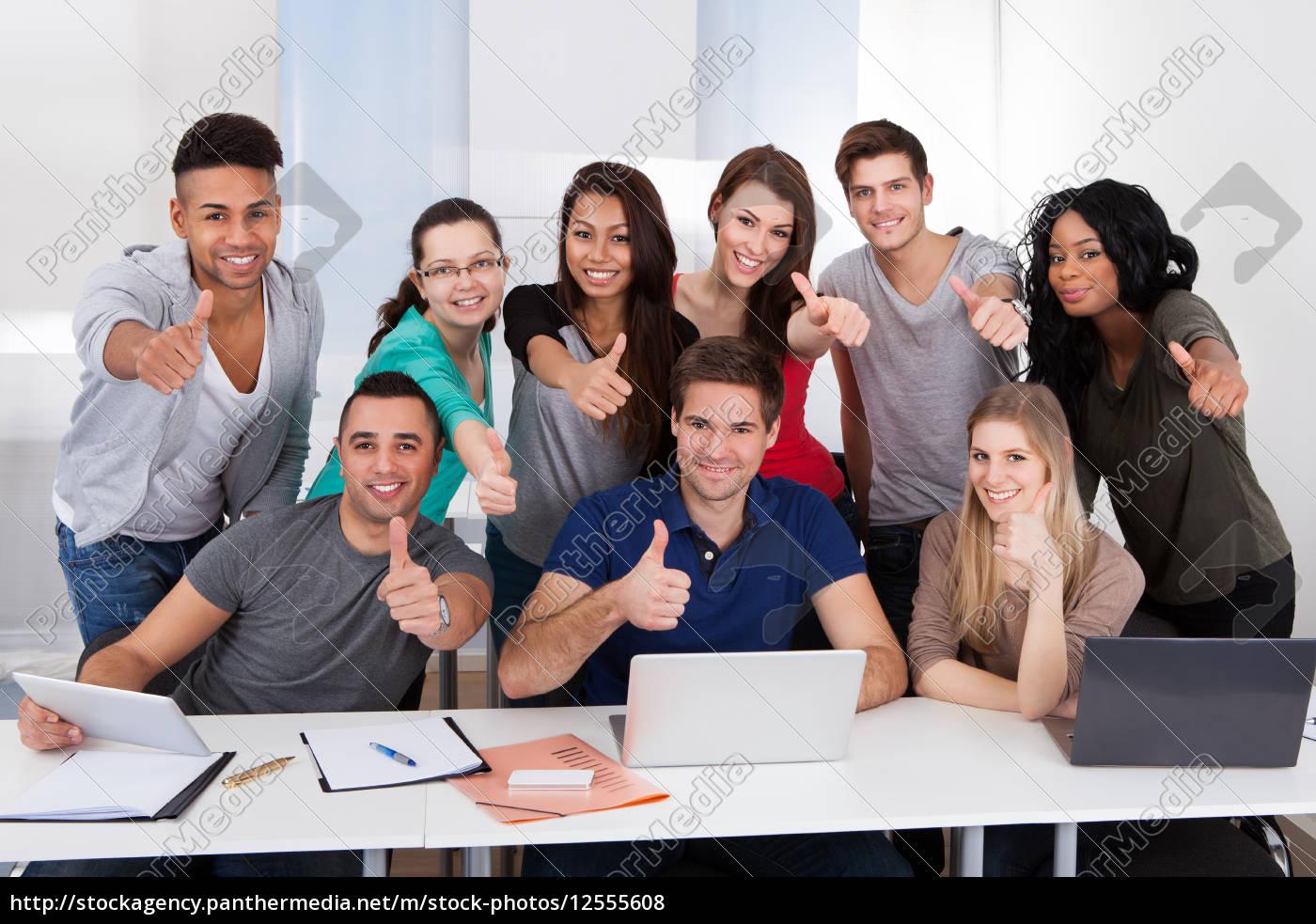 college, students, gesturing, thumbs, up, sign - 12555608