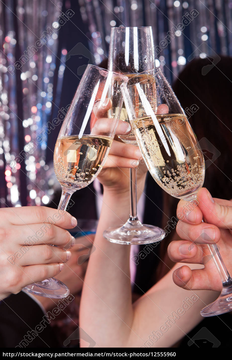 friends, toasting, champagne, at, nightclub - 12555960