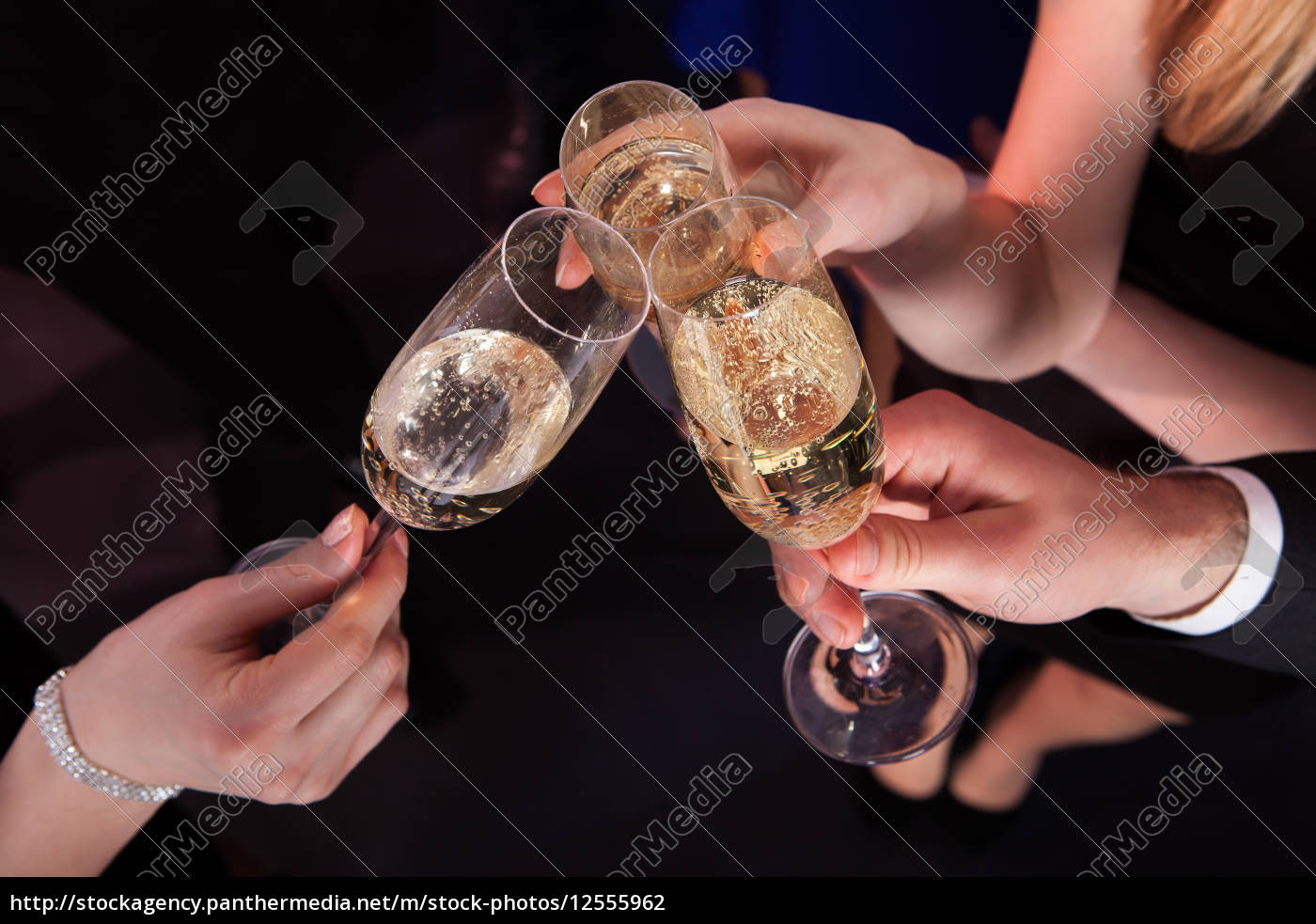 friends, toasting, champagne, at, nightclub - 12555962