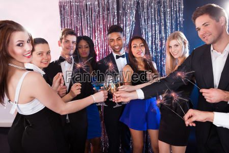happy, friends, toasting, drinks, at, nightclub - 12555970