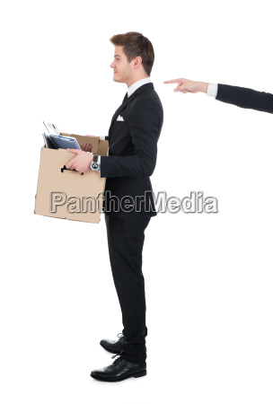 businessman carrying cardboard box with hand
