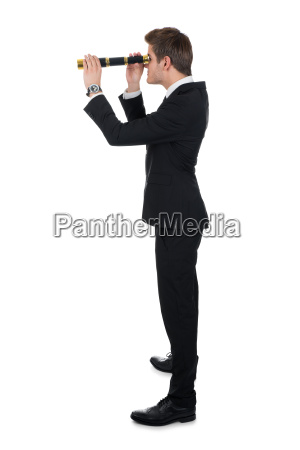 businessman, looking, through, handheld, telescope - 12556906
