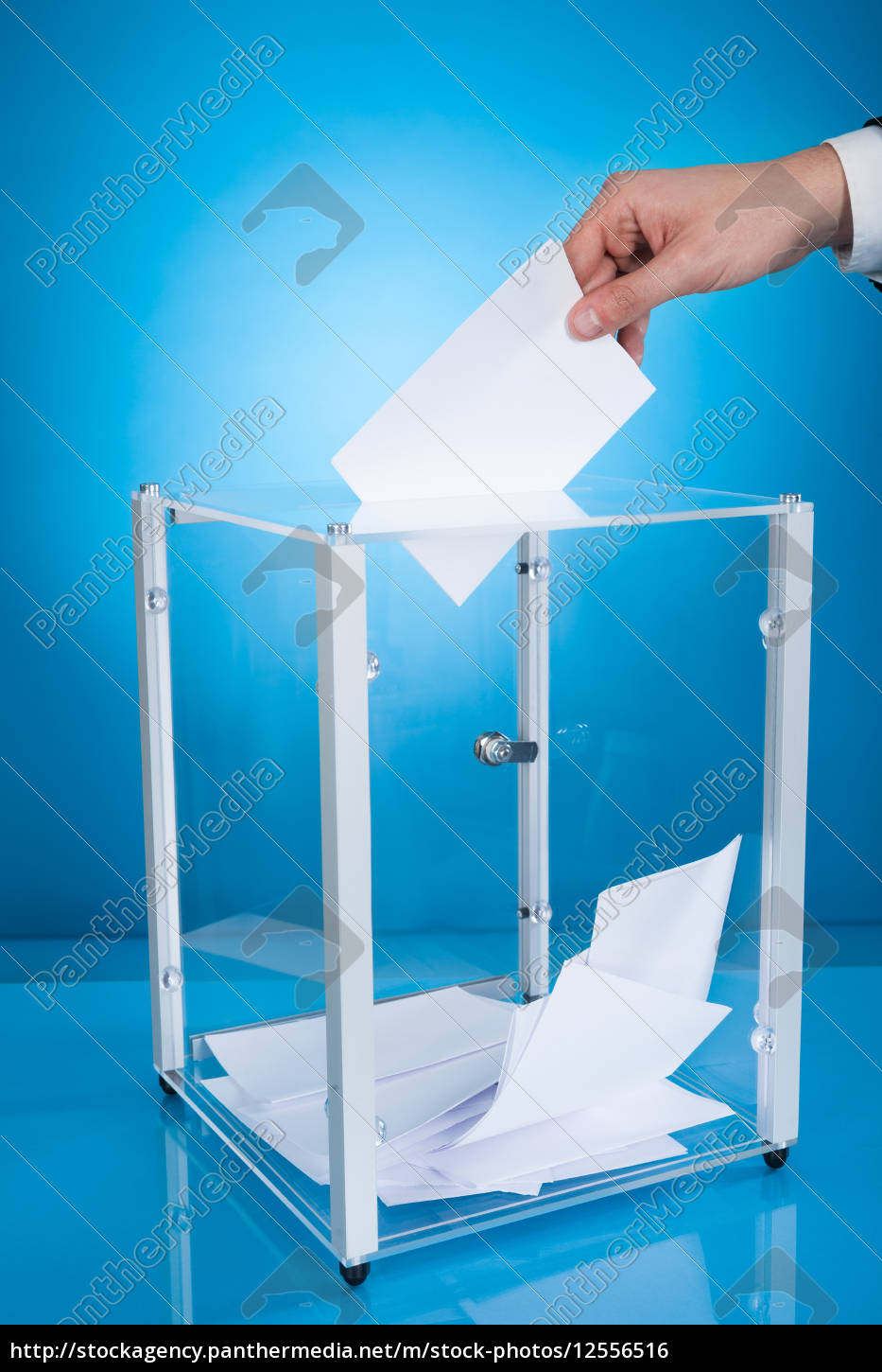 businessman, putting, paper, in, election, box - 12556516