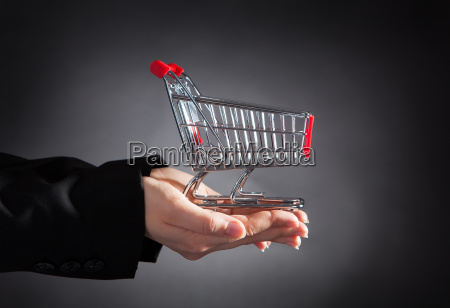 businessperson with shopping cart