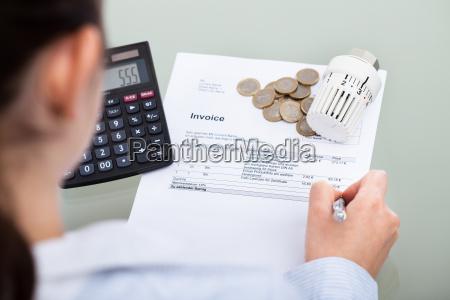 businessperson, analyzing, invoice - 12557478