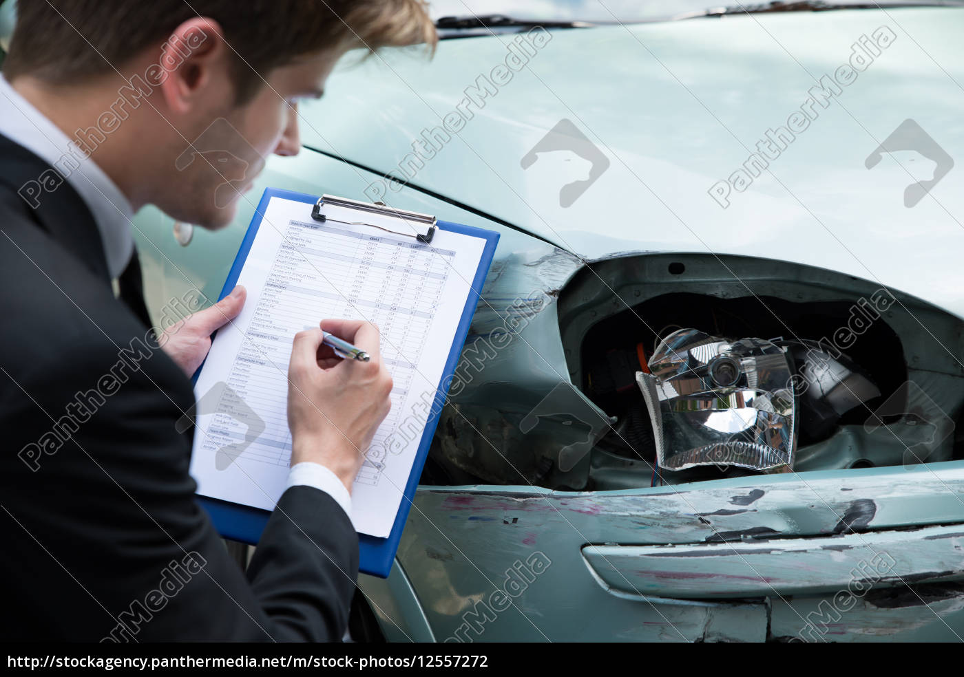 insurance, agent, examining, car, after, accident - 12557272