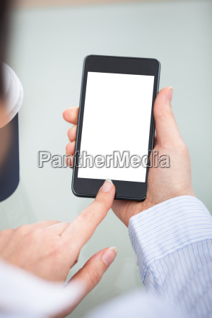 businessperson hand on blank screen mobile