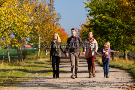 family taking a walk in autumn