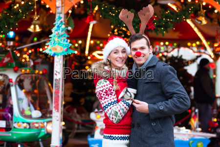 couples at the christmas market during