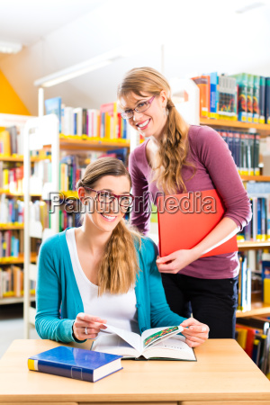 students in library form a study