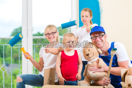 father and daughters renovating a room