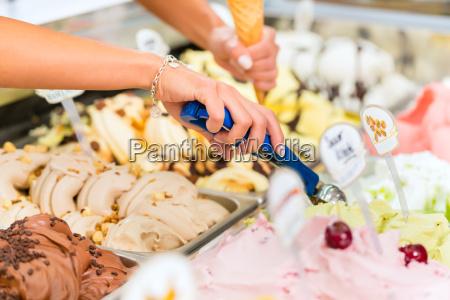 customers in eisladen or ice cream