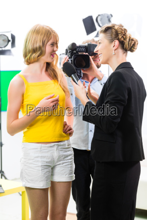 reporter and cameraman are making an