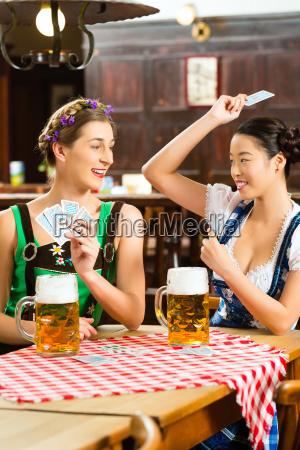 wirtshaus friends drink beer in