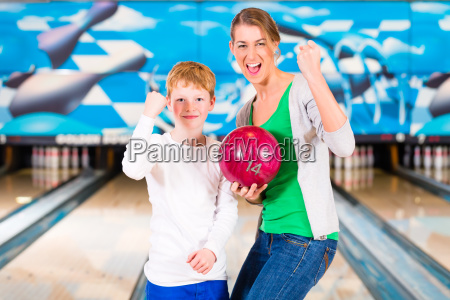 mother and child at bowling