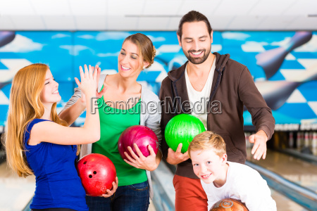 family in bowling center