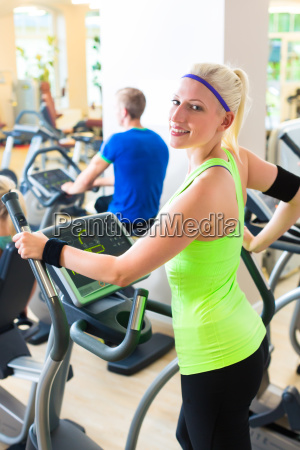 people on treadmill in gym