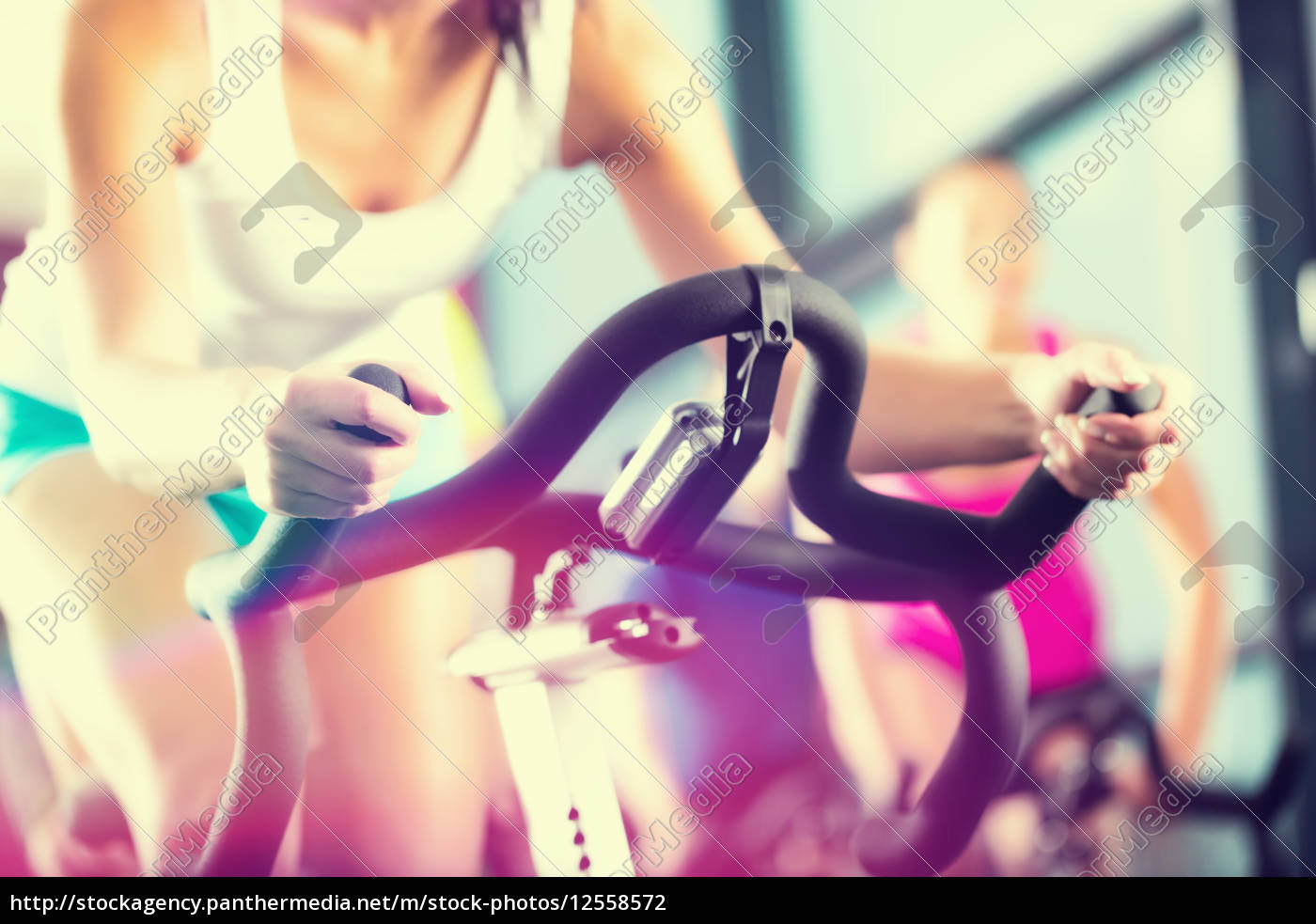 people, at, spinning, at, a, gym - 12558572