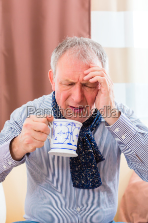 senior, drinking, tea, and, cure, colds - 12558906