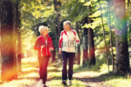 seniors, jogging, in, forest - 12558562