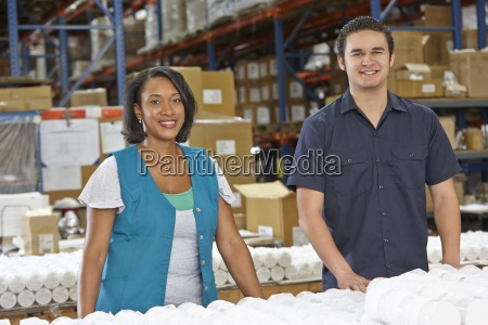 factory workers checking goods on production