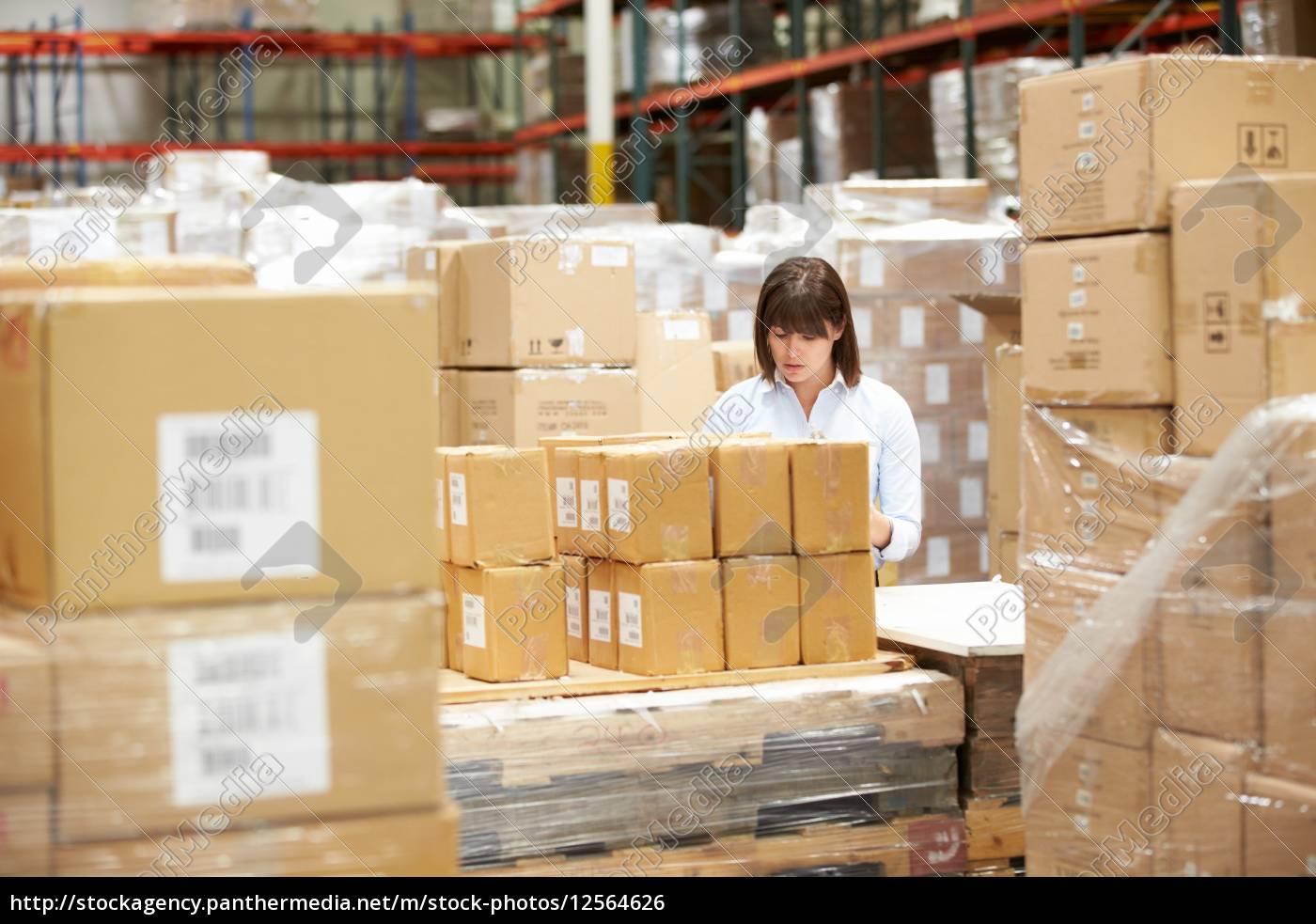 worker, in, warehouse, preparing, goods, for - 12564626
