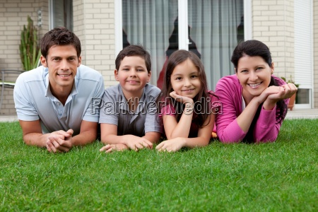 portrait of happy young family lying