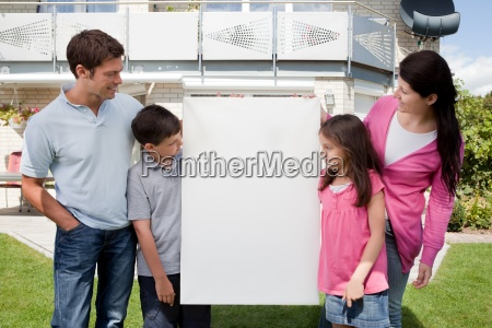 family looking at a empty board