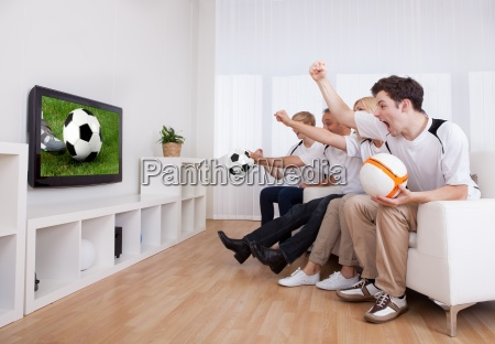 jubilant family watching television