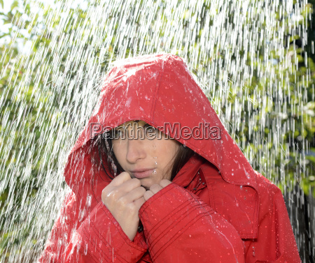 woman with hood in the rain