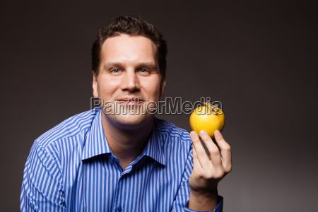 diet nutrition happy man holding apple
