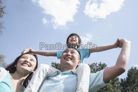 happiness bonding father son mother idyllic