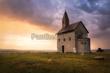 old roman church at sunset in