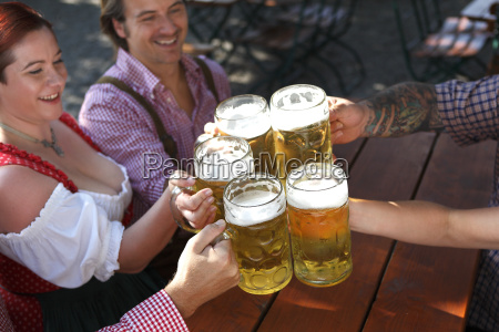 people drinking beer in a traditional