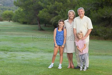 grandparents standing with their grandchildren portrait