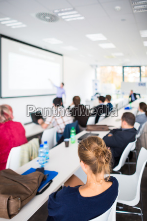 people listening to a presentation in