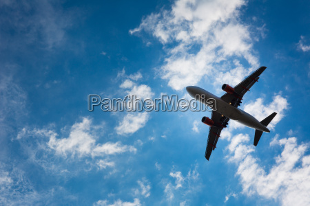 dark silhouette of an airplane flying