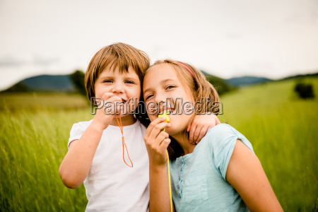 children blowing whistle