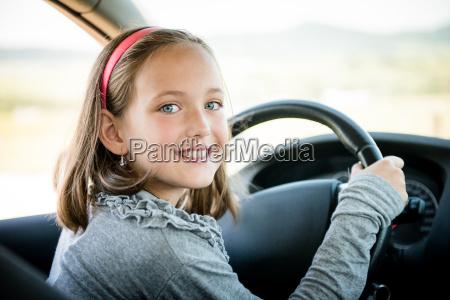 child driving car