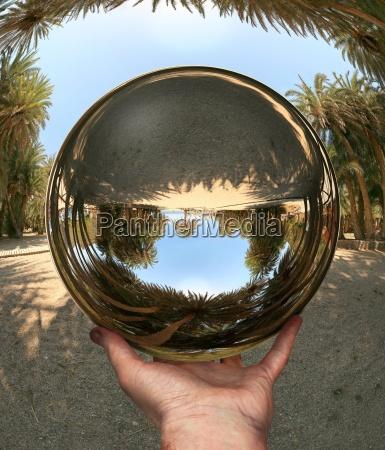 glass sphere in hand vai crete