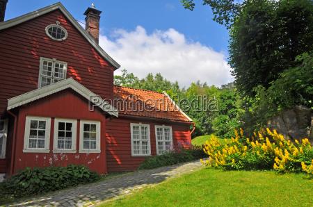 classic red scandinavian wooden house in